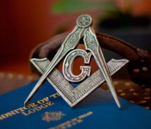 Masonic G pin on book